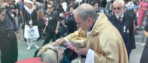 Il Vescovo Mogavero con un ammalato a Lourdes.